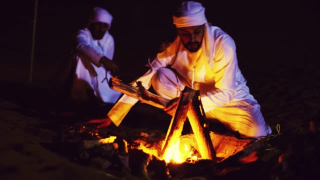 arabs lighting up the bonfire in the desert - sand dune stock videos & royalty-free footage