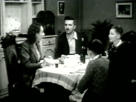 arabs listening to radio, french family at diner table listening. radio, philippe petain picture on wall bg. boys listening at table. wwii - north africa stock videos & royalty-free footage