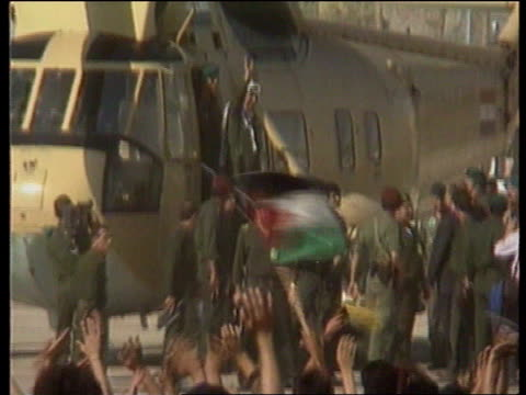 Arafat arrives in Jericho city C4N Jericho Westland Commando helecopter comes in to land as PLO supporters wave flags PAN LMS Yasser Arafat waves to...