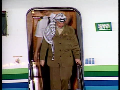 Arafat arrives in Washington USA Maryland Andrews Air Force Base LMS Palestinian President Yasser Arafat out of plane down steps into crowd of men MS...