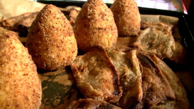 arancini di riso siciliani - croquette stock videos and b-roll footage