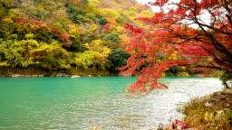 Arashiyama in autumn season along the river in Kyoto, Japan.