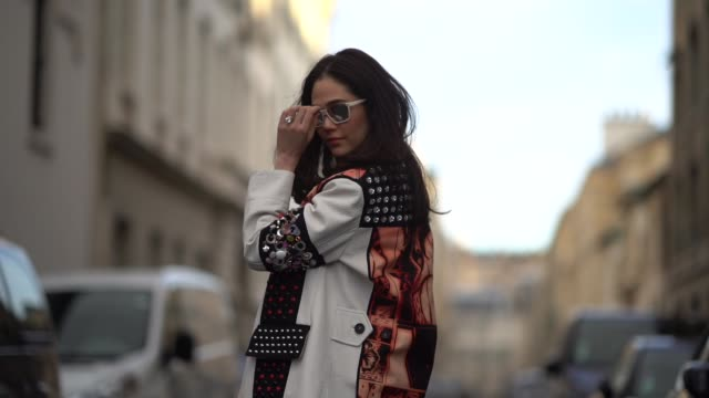 araya hargate wears sunglasses a white blazer jacket with prints a black dress a hermes bag outside hermes during paris fashion week womenswear... - hermes designer label stock videos and b-roll footage