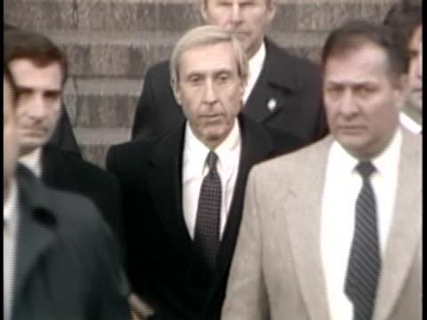 vídeos y material grabado en eventos de stock de arbitrageur ivan boesky walks out of a building and down steps, surrounded by a group of men. - rodear