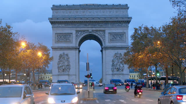 arc de triomphe and avenue des champs elysees at dusk - arch stock videos & royalty-free footage