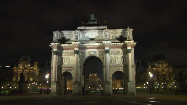 WS Arc de Triomphe du Carrousel and Louvre in background illuminated at night, Paris, France