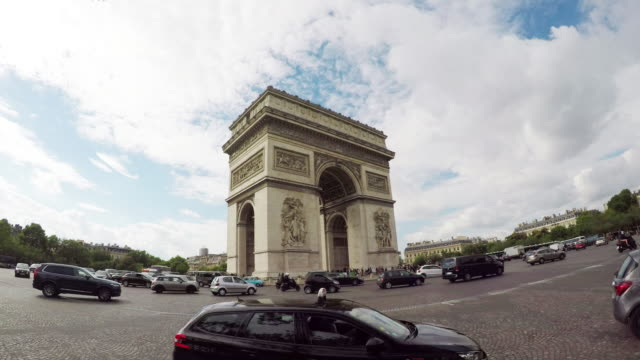 Arc de Triomphe (Arch of Triumph) in is Paris with traffic.
