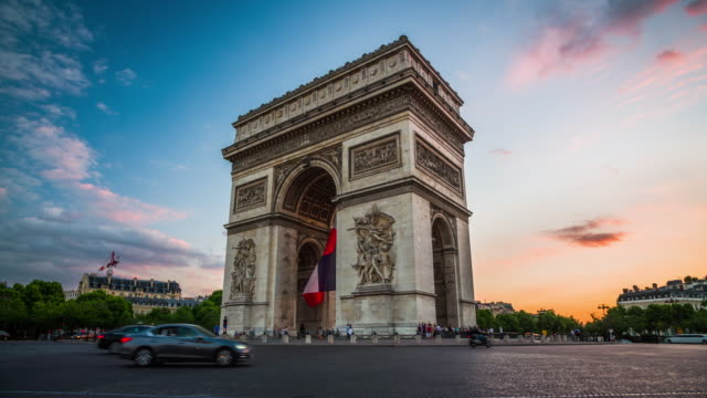 arc de triomphe in paris, france at sunset - romantic sky stock videos & royalty-free footage