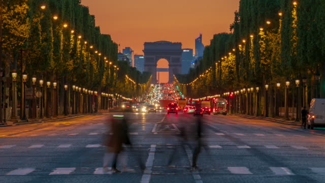 arc de triomphe monument and avenue des champs-élysées in paris - 4k time lapse - paris france stock videos & royalty-free footage