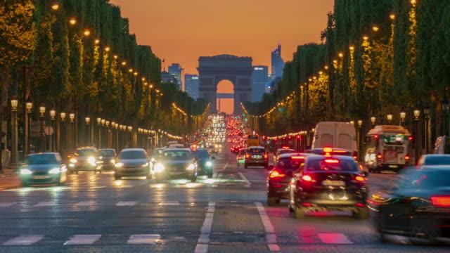 arc de triomphe monument and avenue des champs-élysées in paris - 4k time lapse - avenue des champs elysees stock videos & royalty-free footage