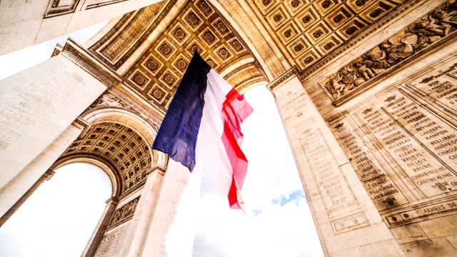 arc de triomphe with french flag - french flag stock videos and b-roll footage