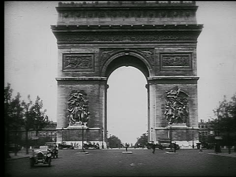 B/W 1926 L'Arc de Triomphe with traffic on street in foreground / Paris, France