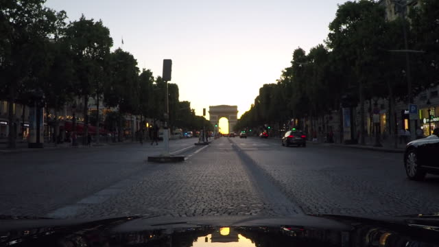 arc de triomphe,paris.tracking shot from vehicle.slow-motion. - moving process plate stock videos and b-roll footage
