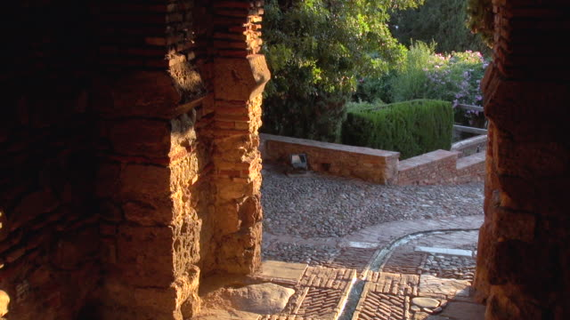 arc gate at alcazaba with flowing water - segovia stock videos & royalty-free footage