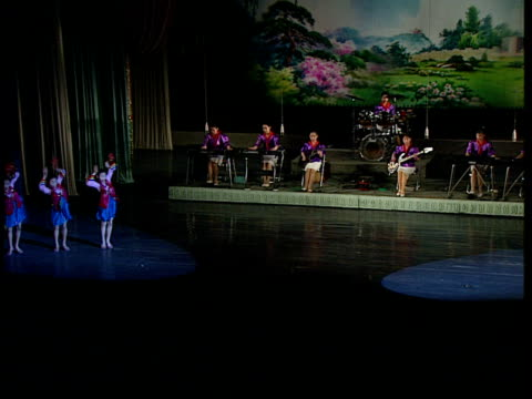 Arc of Triumph / Childrenlearning engineering and music at the Mangyongdae Children's Palace Various of a musical show being performaed on stage with...