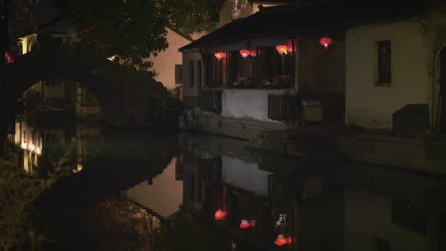 ws arch bridge over canal at night, zhouzhuang, kunshan, jiangsu province, china - arch bridge stock videos & royalty-free footage