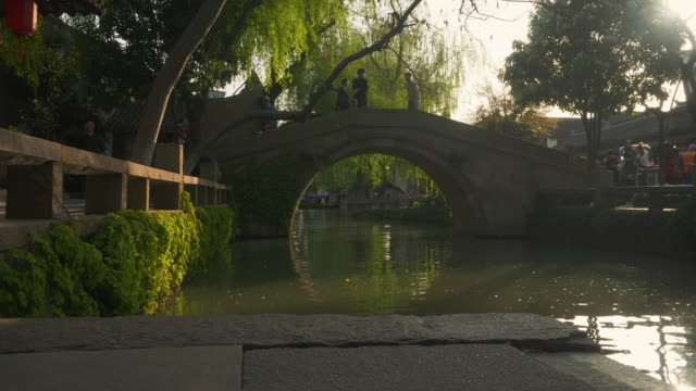 ws arch bridge over canal, zhouzhuang, kunshan, jiangsu province, china - arch bridge stock videos & royalty-free footage