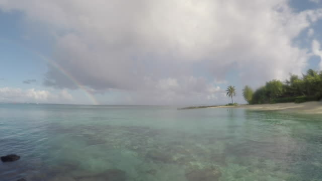 arch in island on the sea, in the lagoon of the island of Huahine