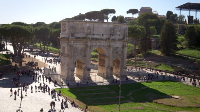 arch of constantine surrounded by tourists in rome, italy - arch of constantine stock videos and b-roll footage