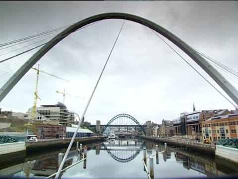 arch of gateshead millennium bridge tyne bridge in background - tyne bridge stock videos & royalty-free footage