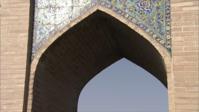 CU TD Arch of Khaju Bridge and people walking on riverbank, Isfahan, Iran