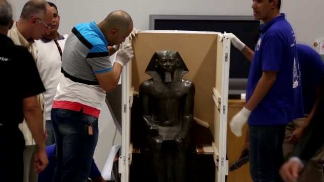Archaeological experts move 10 colossal statues including statues depicting the King Khafre and goddess Hathor from the Egyptian Museum to the...