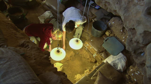 tu archaeological researchers digging inside the blombos caves / south africa - archaeology stock videos & royalty-free footage
