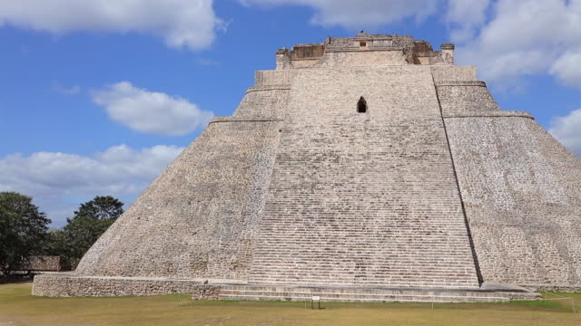 archaeological sites of pyramid of the magician in maya ruin complex of uxmal an mayan step pyramid ( muul waay - maya culture) in mexico - pre columbian stock videos & royalty-free footage