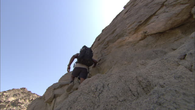archaeologists climb to a roman fort in shenshef, egypt. - free climbing stock videos & royalty-free footage