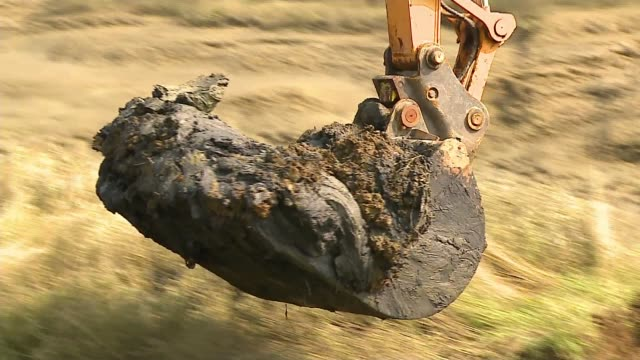 archaeologists dig up plane shot down over essex during world war two uk essex thurrock various shots of excavation team and digger searching for... - wrack stock-videos und b-roll-filmmaterial