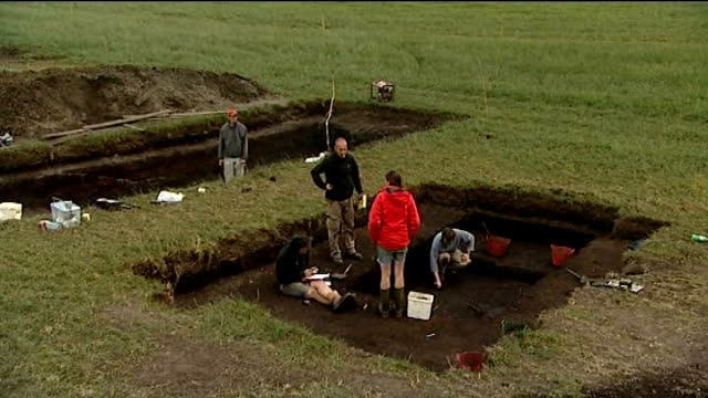 stockvideo's en b-roll-footage met archaeologists discover prehistoric home in scarborough england yorkshire scarborough star carr ext archaeologists at work on site archaeologists... - scarborough engeland