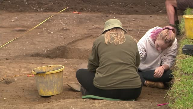 archaeologists find lost monastery of cookham; england: berkshire: near maidenhead: cookham: ext archaeologists working in trench on dig site trowel... - hole stock videos & royalty-free footage