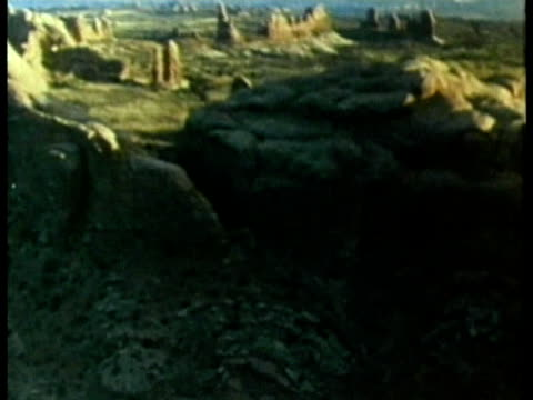 1985 AERIAL MONTAGE WS TD Archaeologists working on an excavation of Native American pueblo ruins AUDIO / New Mexico, USA