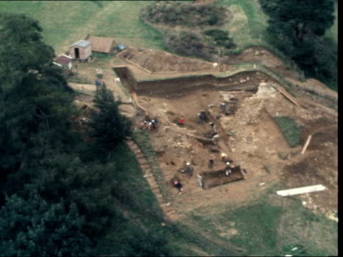 camelot excavations:; england: somerset: cadbury castle: ext air view cadbury castle: trees and fields surrounding digs air view ditto l-r to... - timber stock videos & royalty-free footage