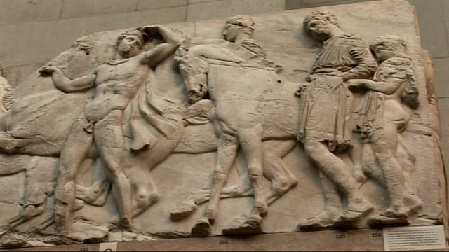 elgin marbles; england: london: british museum: int various of elgin marbles on display - including some close shots and vistors looking at marbles - british museum stock videos & royalty-free footage