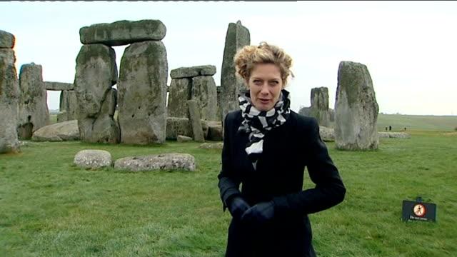 archaeology: geologists find origin of stonehenge blocks; england: wiltshire: salisbury plain: ext gv stonehenge to reporter to camera gv stonehenge... - finding stock videos & royalty-free footage