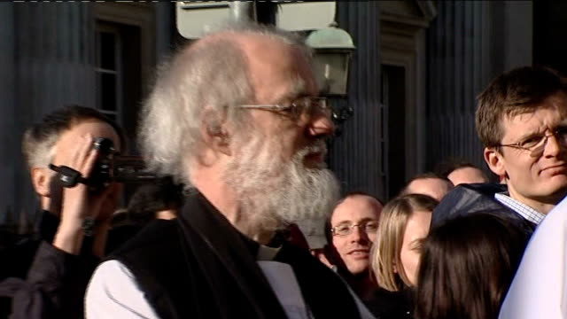 stockvideo's en b-roll-footage met carey remarks tx england cambridge ext england cambridge ext doctor rowan williams outside church with other church members - wet