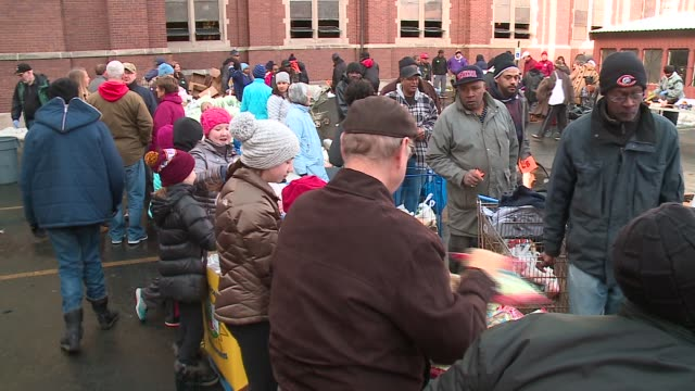 archbishop blasé cupich joined dozens of volunteers from churches across chicagoland, handing out thanksgiving meals to families in need outside of... - south america video stock e b–roll