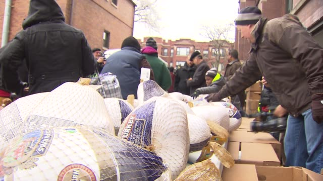 archbishop cupich participated in the distribution of 600 thanksgiving turkeys at the st columbanus parish food pantry on nov 26 2014 - religiöse stätte stock-videos und b-roll-filmmaterial