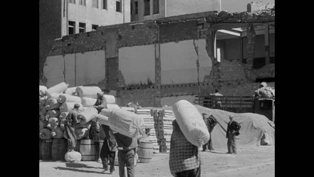 vidéos et rushes de archbishop damaskinos in meeting w/ two men from unrra . docks: boxes sacks mule being unloaded from ship. workers moving boxes sacks. herd of mules... - athens greece