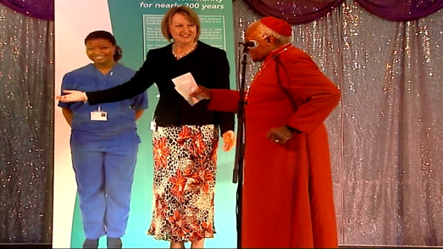 vídeos de stock, filmes e b-roll de archbishop desmond tutu opens riverside unit at lewisham hospital england london lewisham int archbishop desmond tutu jokes as audience laugh during... - desmond tutu