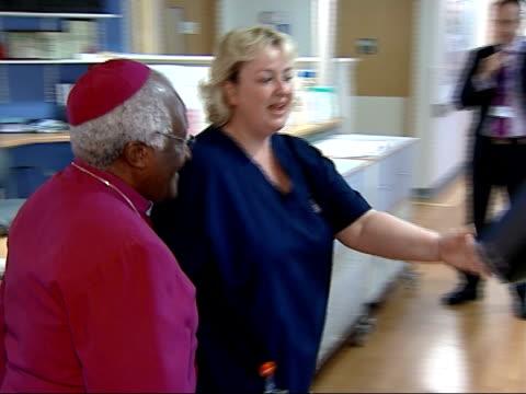 archbishop desmond tutu opens riverside unit at lewisham hospital service / hospital tour / speech more of tutu touring lewisham hospital ext tutu... - tutu stock videos & royalty-free footage
