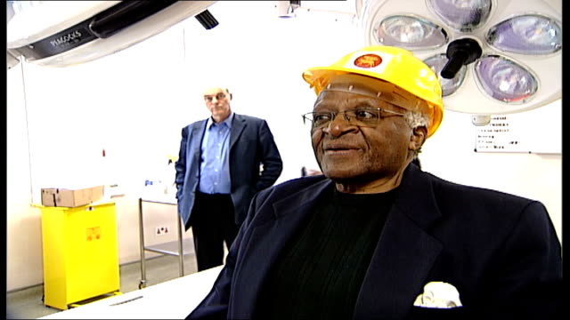 archbishop desmond tutu visits st luke's hospital in london tutu wearing safety helmet posing for photocall in front of medical equipment tutu... - tutu stock videos & royalty-free footage