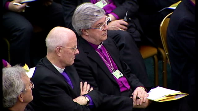 archbishop of canterbury addresses synod on sharia controversy church house int williams addressing synod various shots of audience listening dr... - parallelo video stock e b–roll