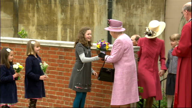 archbishop of canterbury and pope easter messages berkshire windsor ext queen elizabeth ii out of windsor chapel and accepts bouquets of flowers from... - archbishop of canterbury stock videos and b-roll footage