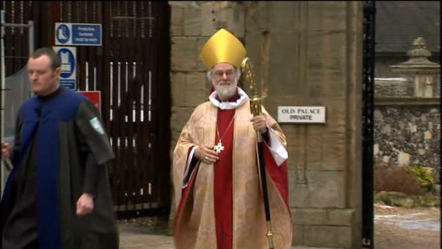 archbishop of canterbury arrives for christmas day service; england: kent: canterbury: canterbury cathedral: ext clergy along to christmas day... - canterbury cathedral stock videos & royalty-free footage