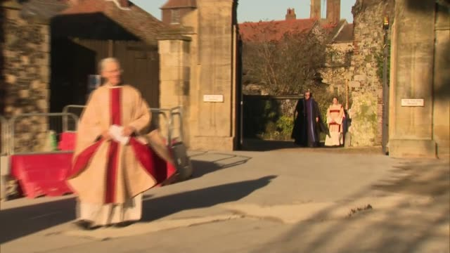 archbishop of canterbury christmas day sermon; england: kent: canterbury: canterbury cathedral: ext justin welby arriving in procession - archbishop of canterbury stock videos & royalty-free footage