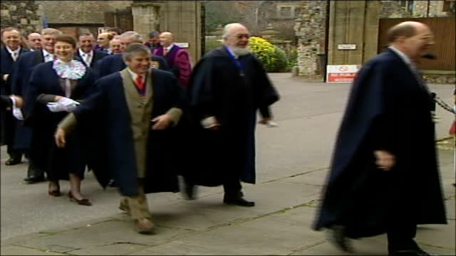 archbishop of canterbury christmas message; england: canterbury: canterbury cathedral: ext procession of dignitaries along into cathedral procession... - canterbury cathedral stock videos & royalty-free footage