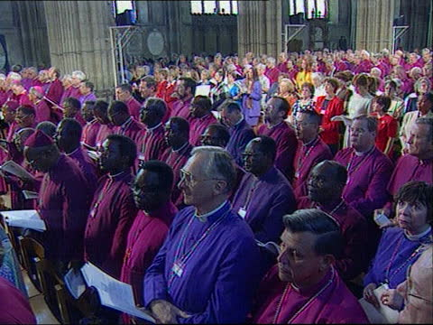 archbishop of canterbury confirms no gay clergy; a)22.30 england: kent: canterbury cathedral: ext procession of bishops along and into cathedral int... - canterbury cathedral stock videos & royalty-free footage