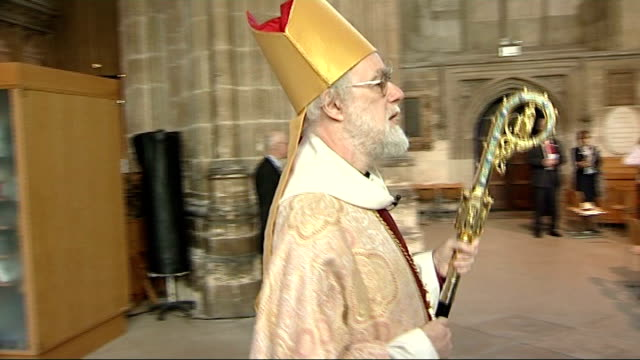 archbishop of canterbury criticises coalition government policies; lib kent: canterbury cathedral: int dr rowan williams entering cathedral for... - canterbury cathedral stock videos & royalty-free footage